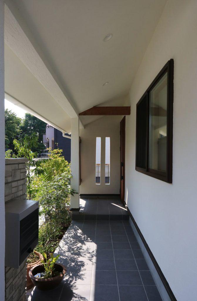 2度目の家づくりで実現した 健康 安住 の家 家 玄関 格子 玄関ポーチ