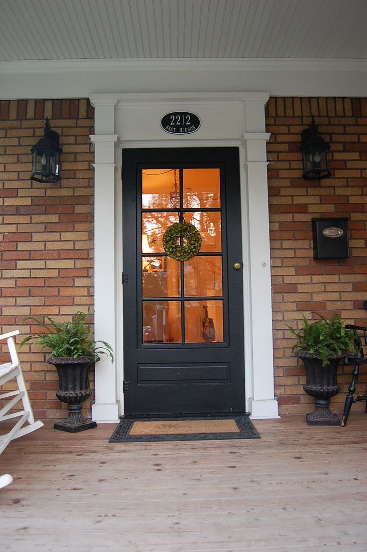 glass front door painted black with white