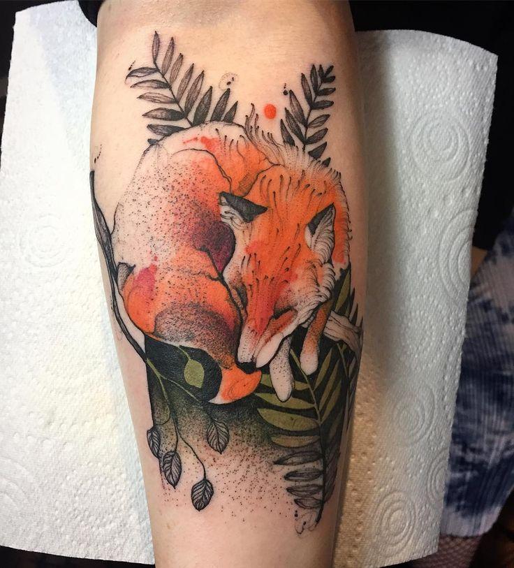 Tattoo sleeping fox leaves
