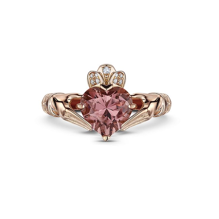 "Majestic Princess Rose:  One of our most delicate female ring 18ct French gold Claddagh inspired ring. 4.3ct diamond faceted heart shape pink tourmaline. 0.42ct diamond shoulders set in the ""Jacey Justin Lattice"" unique style. Accented with diamond pave crown. Available in white and yellow gold"