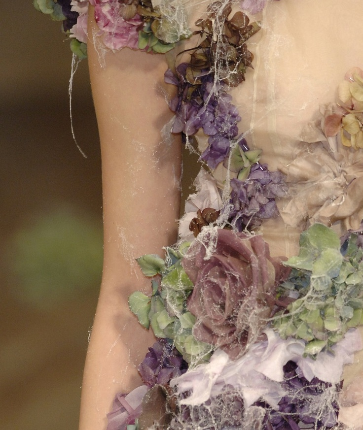 How unusual and delicate...a dress made out of flowers and cobwebs.