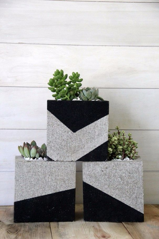 Cinder blocks are an affordable way to craft modern planters for your succulents.