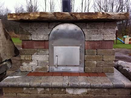 Wood Stove Pools WSP Silver Dome pool heater with stone built around. Nice design!    www.woodstovepools.com
