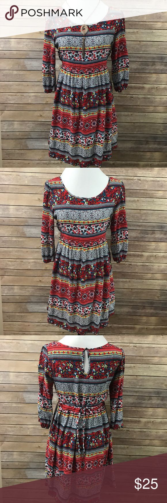 NWOT Fun Floral Dress Gorgeous dress with a fun design! Featuring a floral and Aztec looking design!!! Ties in the back for a tighter or looser wear! New without tags, size Medium!                 🔹18 inches across the bust, 33 inches long Dresses
