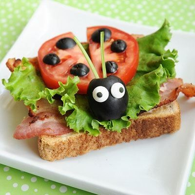 Lady Bug BLT -- A pair of edible icing eyes and a few olives are all one needs turn a BLT into a BL (beautiful ladybug.) meetthedubiens.com