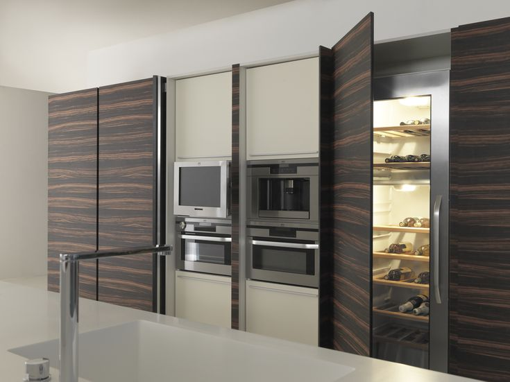 TWENTY tall units with integrated appliances and wine cooler. Retractable doors slide between units allowing complete access to the appliances