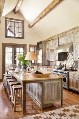 Rustic Kitchen with Hardwood floors, Limestone counters, Exposed beam, French doors, Mis: jura beige limestone counters