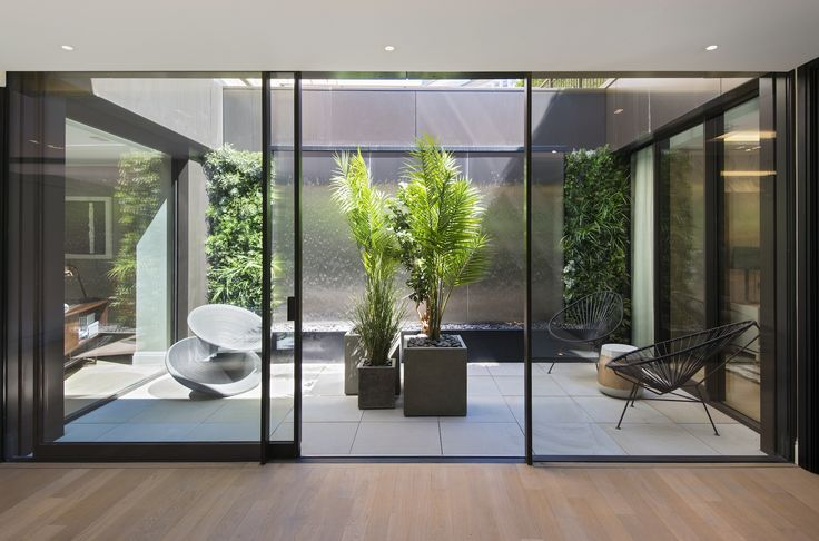1508 London Park Crescent - luxury interior design, courtyard garden with modern furniture.