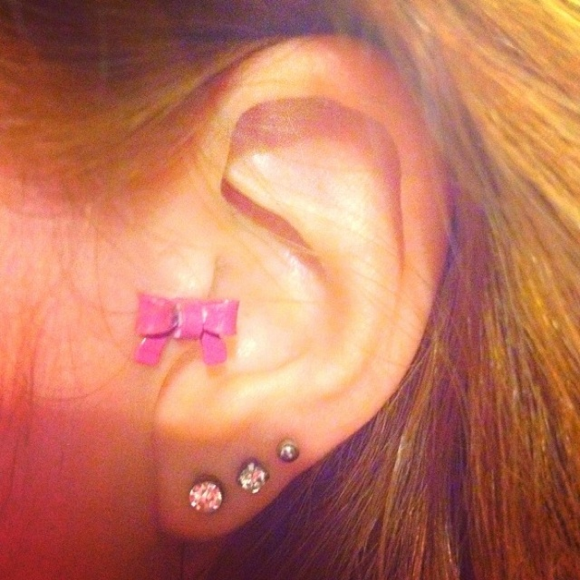 Bow tragus ear piercing having this by summer !