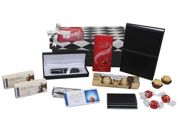 Exec Hamper  Includes: 1 x Exec A5 Notebook, 1 x Conference Pen & Pencil Set, 1 x Exec Cardholder, 1 x Lindt Lindor Single Slab, 1 x Ferrero Rocher Box, 2 x Sally Willaims Choc Bars, 1 x Lindt Lindor Box and 1 x Lindt Excellence Sla Colours: Blach -silver Material: N/A sIZE :22 (w) x 13 (h) x 17.5 (d) Branding methods:Silk Screening  (Default Method) , Engraving , Sticker , Full Colour Print