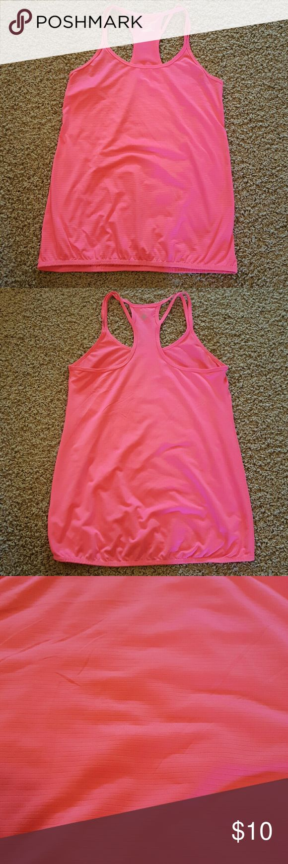 Bright pink workout tank Bright pink workout tank. Is loose, but has a small band at the bottom. (Not Zella, just used for exposure.) Zella Tops Tank Tops