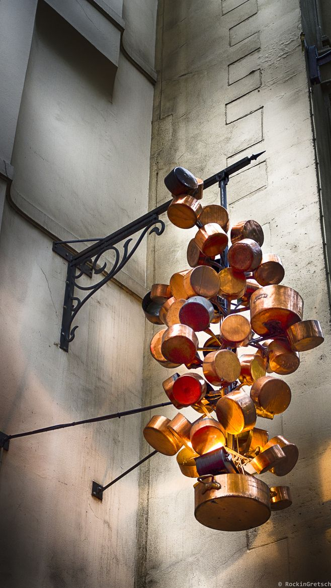 Copper pots artistically recreated into an outdoor light fixture at a restaurant in Paris.....     ᘡղbᘠ
