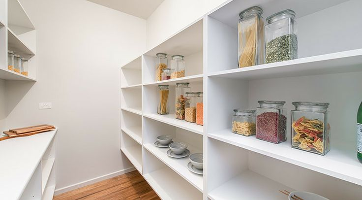 This spacious walk in pantry provides extensive storage for the avid cook. #pantry #kitchen