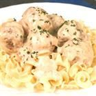 Swedish Meatballs I - Meatballs  of ground beef mixed with onion and dry cream of wheat are baked for 20 minutes, combined in a casserole with condensed cream soups and evaporated milk, and baked another 40 minutes.