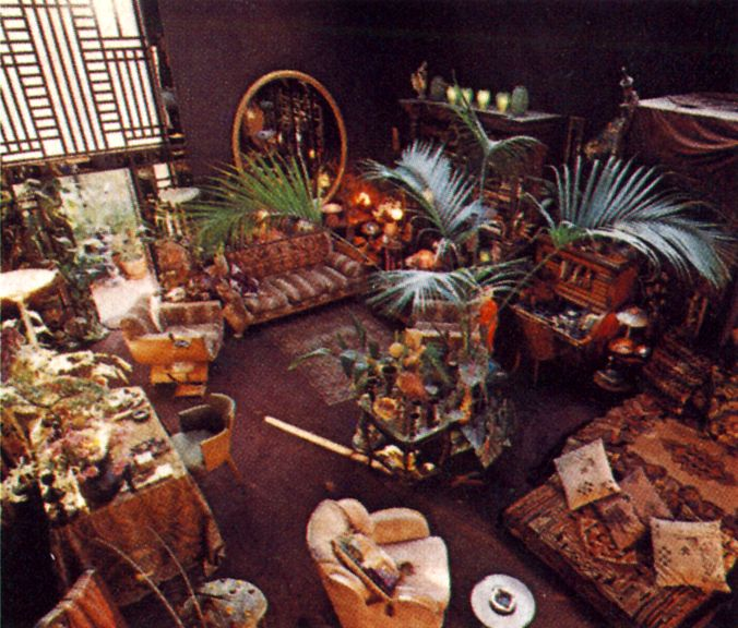 """1975.   Biba founder Barbara Hulanicki's studio home.  Looking down from the gallery into the studio, arranged into its separate """"rooms"""". Photographed by James Mortimer for Vogue."""