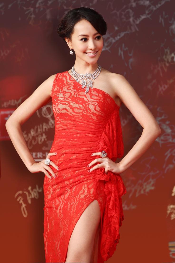 Terri Kwan wearing Piaget Rose earrings (ref. G38U4800) and a Piaget Rose ring (ref. G34U5600)