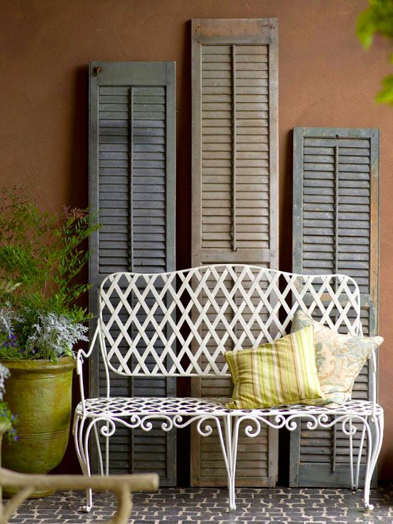 loving these salvaged shutters to add interest to an outdoor sitting area
