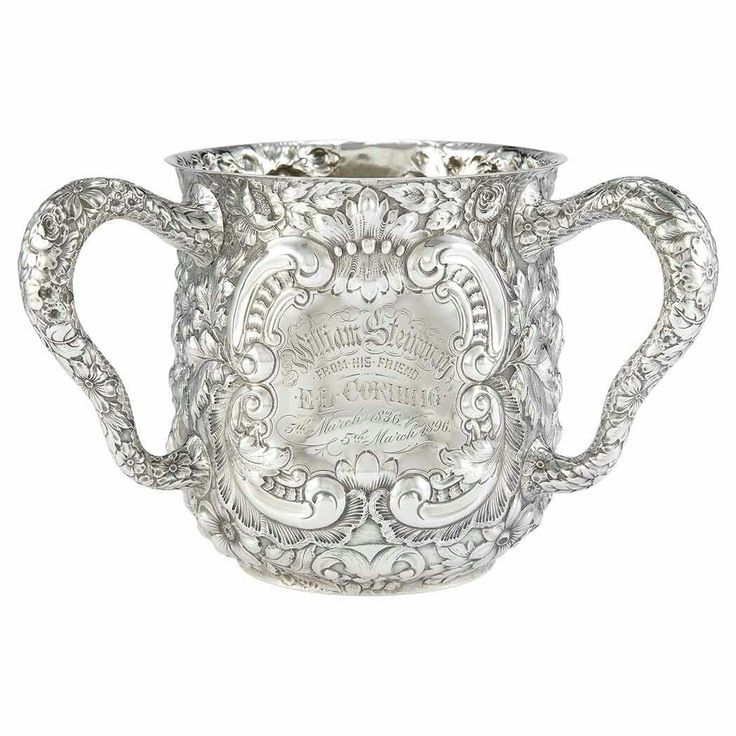 Gorham Sterling Silver Loving Cup Presented to William E. Steinway Circa 1895  With chased and repousse rocaille and foliate motifs, inscribed William Steinway from his friend E.L. Corning 5th March 1836 - 5th March 1896. Height 5 1/2 inches, approximately 21 ounces.  William E. Steinway (1835-1896) was the son of Henry E. Steinway, who founded Steinway & Sons. Erastus L. Corning, Jr. (1827-1897) was the son of Erastus Corning, who was founder and first president of the New York Central…