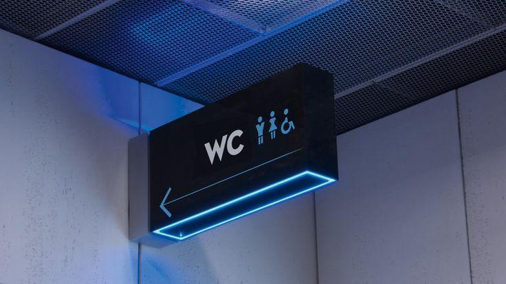 Restroom directional sign