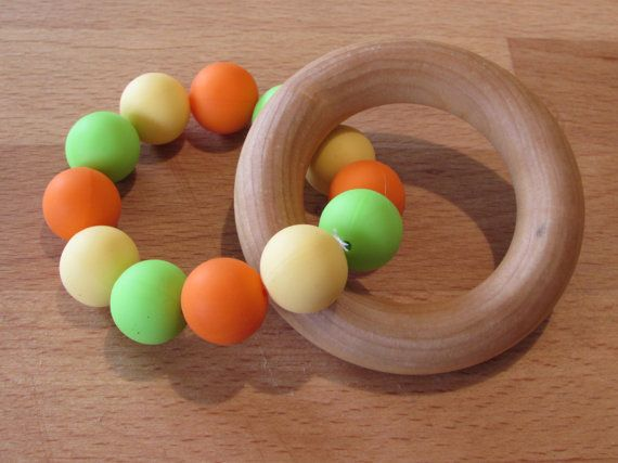 Wooden Silicone Teething Ring A beautiful natural & colourful teether that your baby will love!    The wooden ring is made from natural