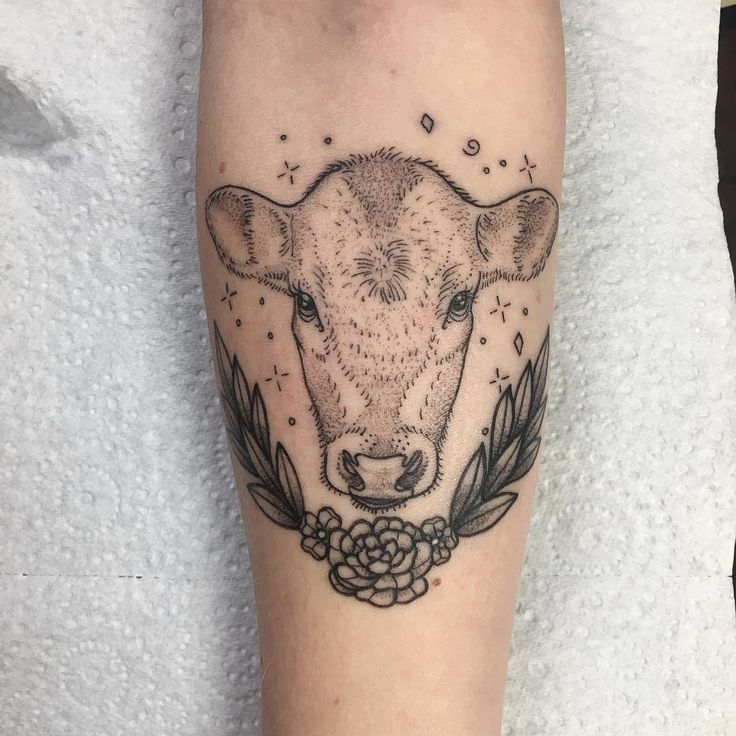 Cow and floral wreath tattoo