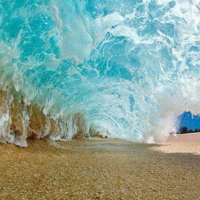Under a wave.