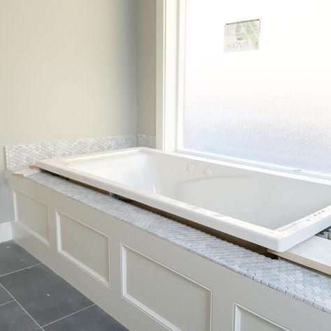 White Jetted Tub With Carrara Hexagon Honeycomb Backsplash And Tub