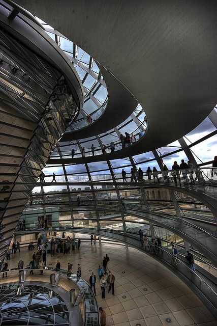 The Reichstag Dome, Berlin Norman Foster The current Reichstag dome is a glass dome, constructed on top of the rebuilt Reichstag building in Berlin. It was designed by architect Norman Foster and built to symbolise the reunification of Germany.