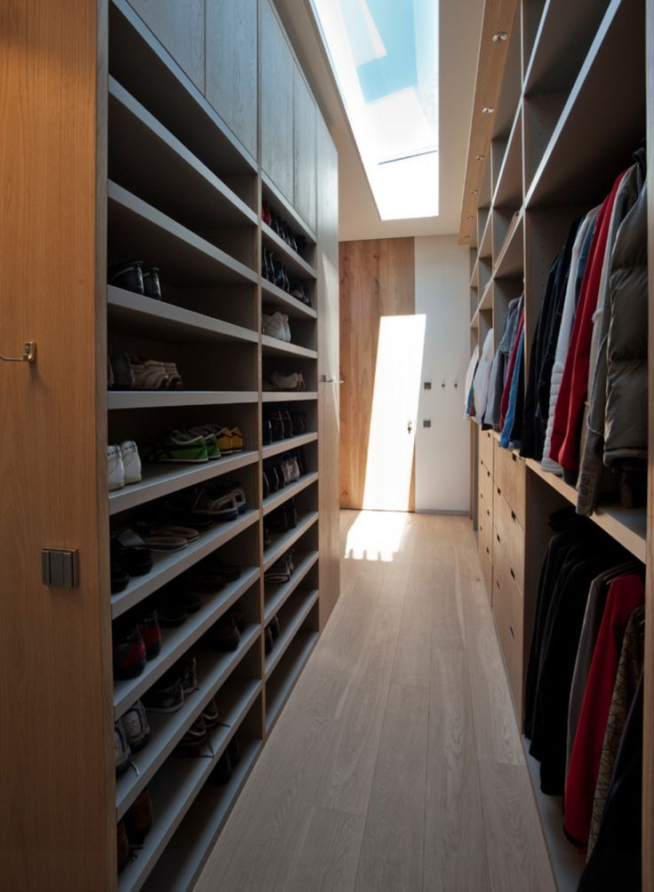 Narrow Walk In Closet With Skylight Closet Behind Bed