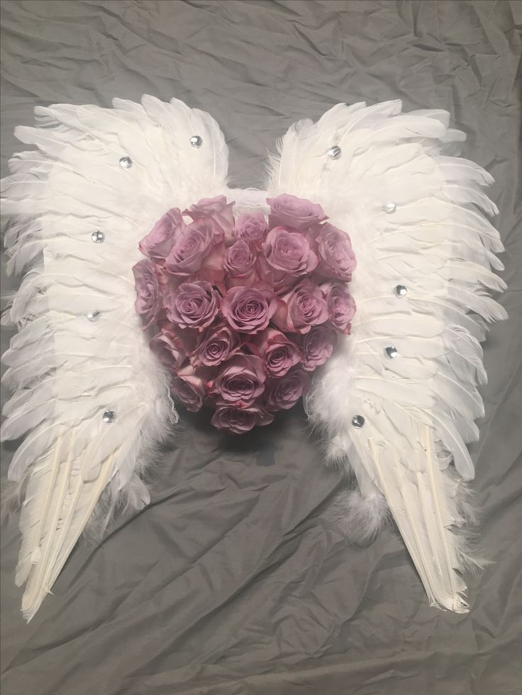 Angel wings funeral flowers