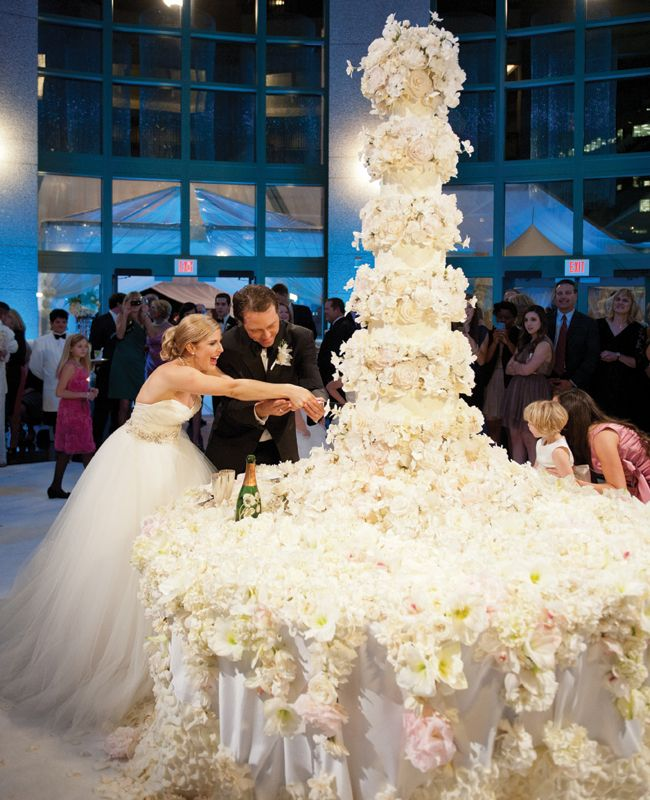In awe of this 5.5-foot tall sugar flower-covered wedding cake!