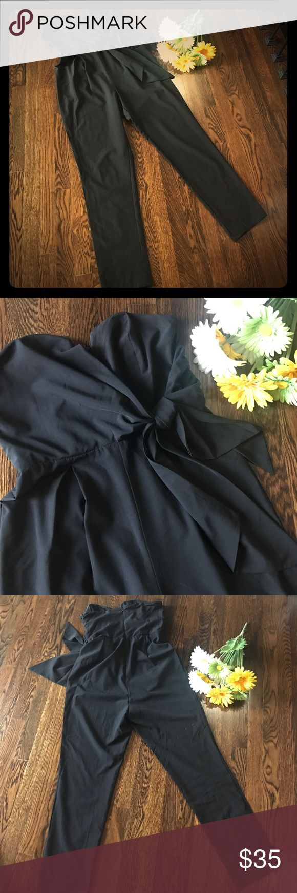 Black Strapless Jumpsuit, Sz M Black strapless jumpsuit with sweetheart neckline and embellished side tie. Pleated to flatter. Brand is Mustard Seed. Lined and boned for support. Fabric has a little stretch. Great with heels for an evening wedding. Mustard Seed Pants Jumpsuits & Rompers