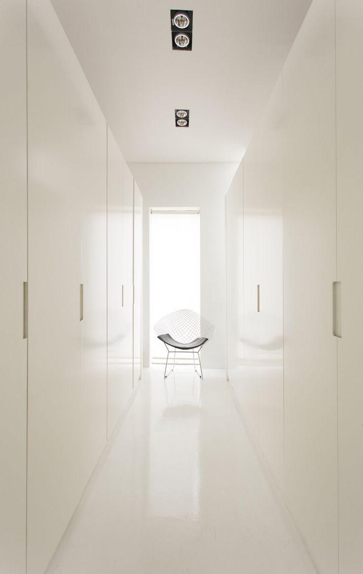 white duco sprayed joinery, white epoxy floor finish, narrow vertical window
