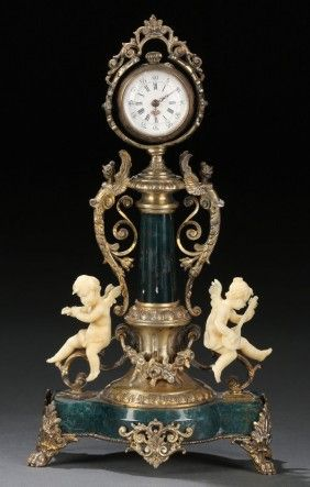 A VERY FINE FRENCH SILVER GILT, HELIOTROPE AND CARVED IVORY CLOCK STAND, 19TH CENTURY.