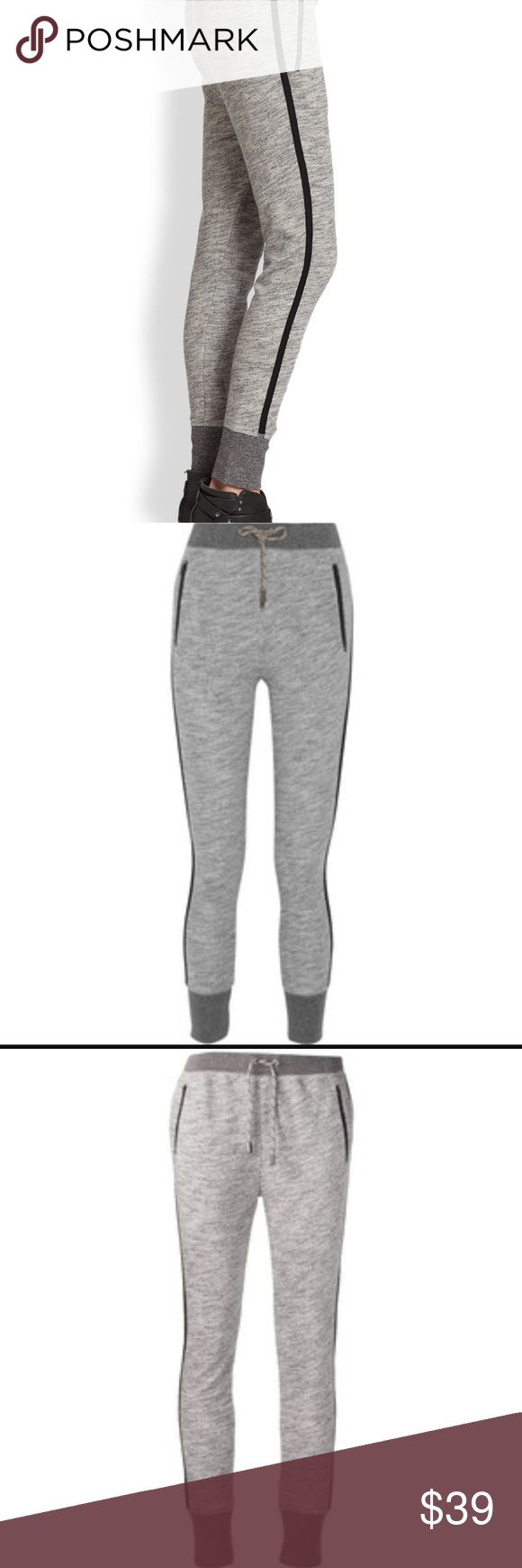 Rag and bone gray and black harem sweatpants Rag and bone size medium grey sweats with black side stripe and size zip pockets. Tie at waist. rag & bone Pants