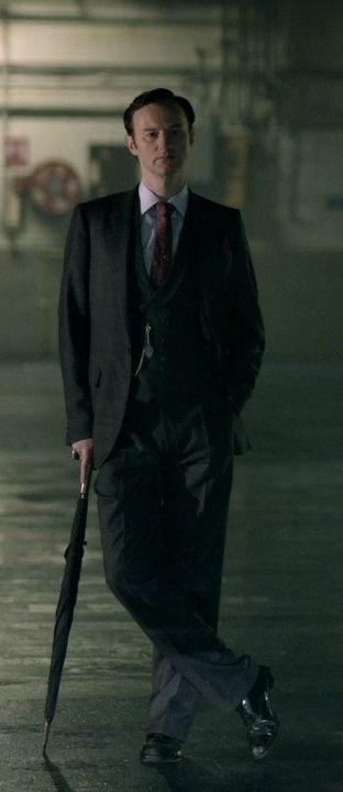 Mycroft being all Mycroft like with his umbrella in a warehouse. Probably wearing his umbrella tie too.