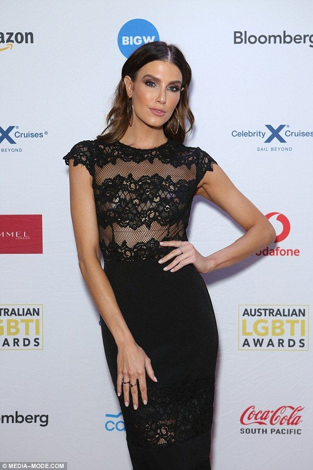 Black beauty! Erin Holland flaunts her incredible physique in a lacy see-through gown at the LGBTI awards in Sydney
