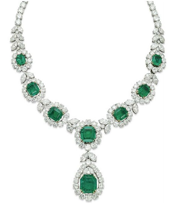 A FINE EMERALD AND DIAMOND NECKLACE, BY VAN CLEEF & ARPELS The detachable front section designed as a series of seven graduated diamond clusters, each centering upon a rectangular-cut emerald, interspersed by twin marquise-cut diamond links, suspending a detachable s1milarly-set pear-shaped pendant, to the brilliant-cut diamond neckchain, the front section can detach to be worn as a bracelet, 1960