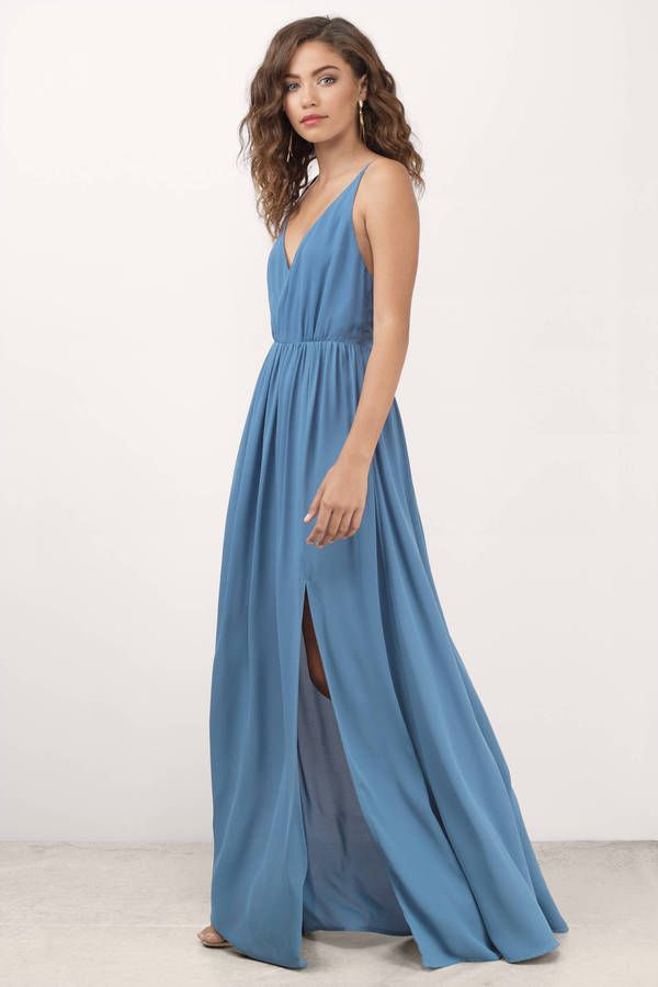 This beautiful blue maxi dress with a side slit and spaghetti straps will definitely turn heads wherever you go!