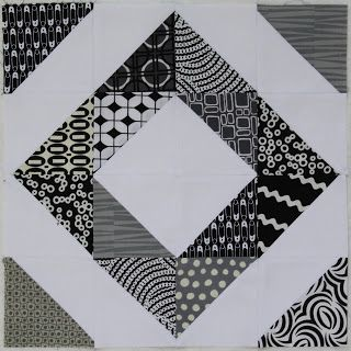 This half-square triangle is also a  strip quilt pattern....that makes it easy; 2 colors makes it striking.!
