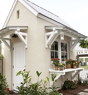 White Garden Shed with Shelf. Gotta get my sons to repaint my shed and will add planter shelves as these look great!
