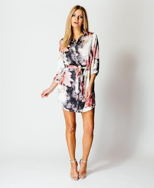 Channel some major style vibes into your collection with this belted shirt dress. With its Floral pattern, satin feel fabric