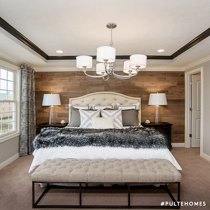 Think of pillows as accessories that complete a look. Stack, lean, and mix and match your pillows to impress guests with a well-made bed! | Pulte Homes