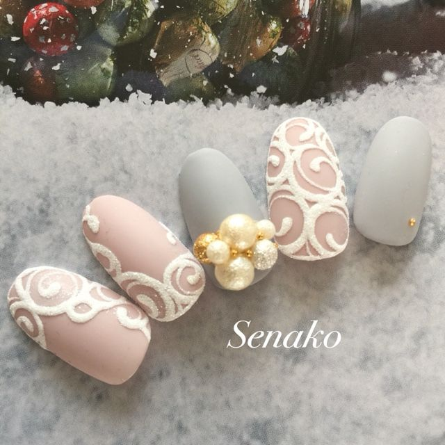 Gray, dusty pink with scroll work and pearl accent nail art