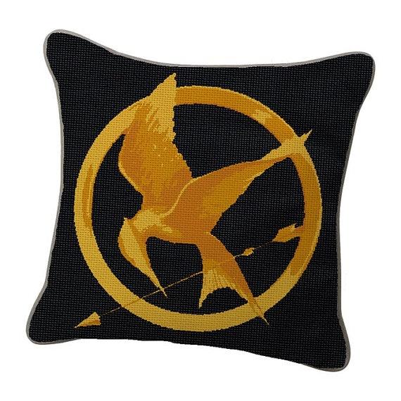 I want a mockingjay pillow!