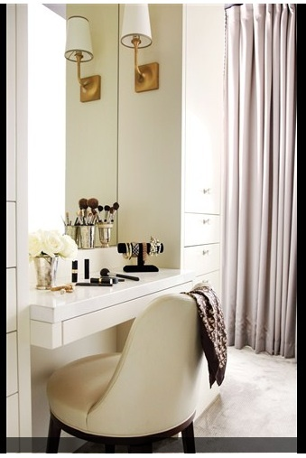 If your bathroom is small, carve out an area in the bedroom for makeup, jewellery and hair drying. (Here a dresser and mirror are positioned behind the bed, which also creates a dividing wall.) A small desk or dresser works