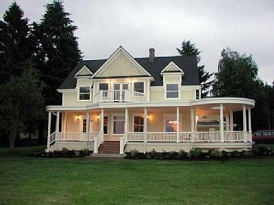 Farmhouse with wrap around porch....love the color!! :0)