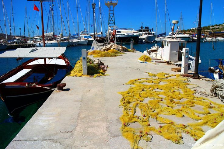 Yellow fishing nets drying on the sun