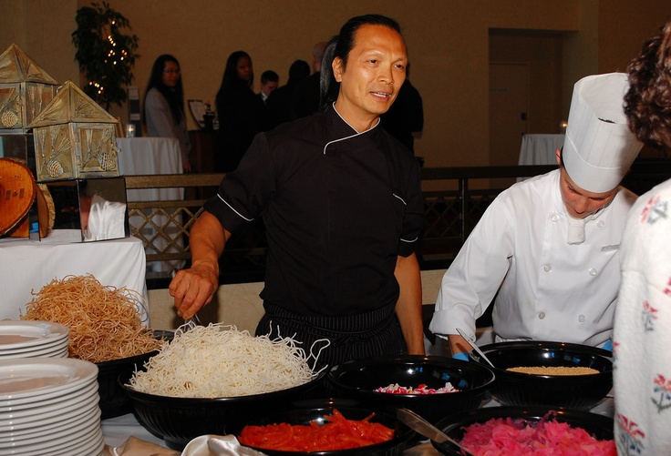Chef Lee discussing his Singaporean type Slaw with guest at Deerhurst.