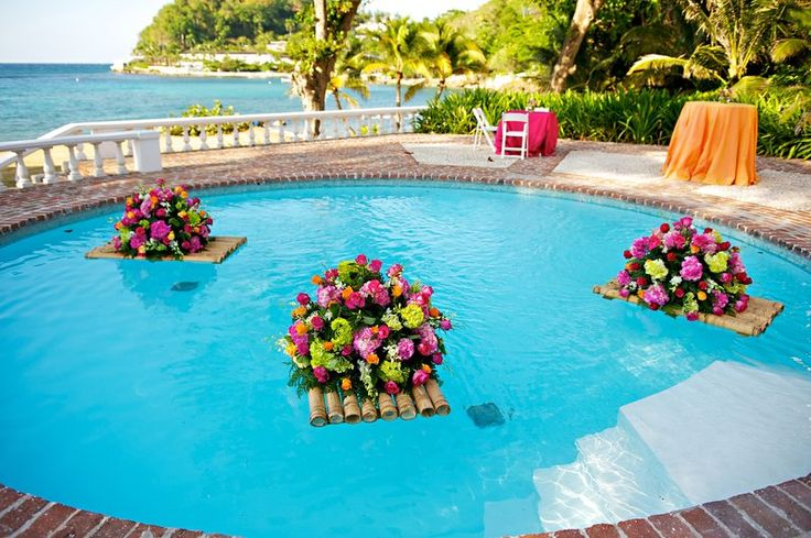 like the idea of floating candles and/or flowers in the pool during the reception.  Not a fan of this particular configuration however (colors).